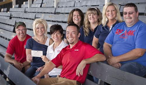 RE/MAX Grand donates to the Save the Grandstand and Ag Society!