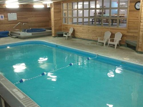 Indoor pool in lower level of building.