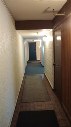 View after entering front door of building into common area hallway of building