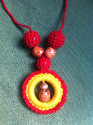 Necklaces also come with wooden beads and hoops covered by crocheted yarn.