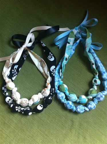 Mamas love the teething/nursing necklaces.  Give baby something to chew on or play with while you hold them.