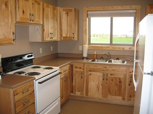 Each cabin kitchen is equipped with with a full sized refrigerator, stove, microwave, coffee pot and toaster.