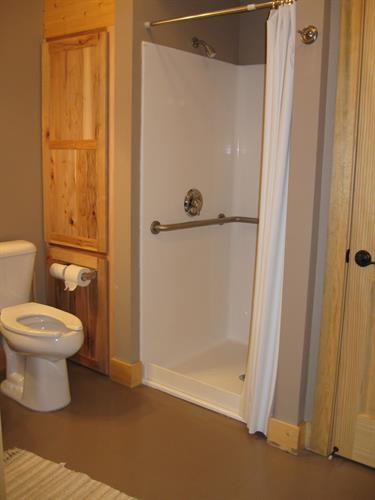 Each family cabin has its own private bath with shower.  The Dorm cabins have two bathrooms each.