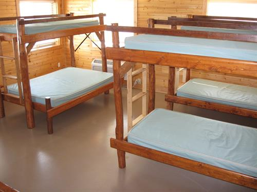 Each Family Cabin sleeps 7.  Dorm Cabins sleep up to 20.