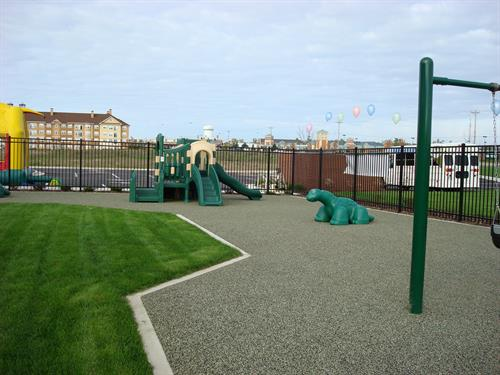 Toddlers enjoy the dinosaur playground.