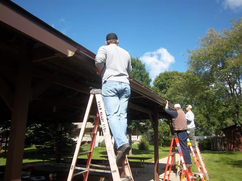 Hanging rain gutters for the rain garden in Florence Park