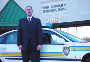 Tom Conley in front of The Conley Group Office