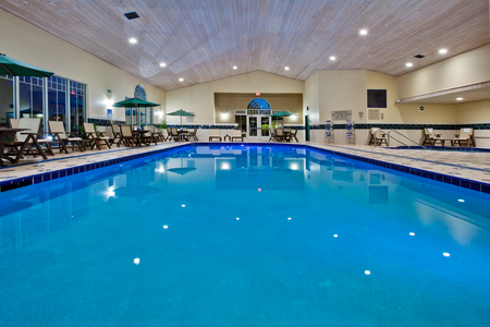 Indoor pool, whirlpool, and fitness center with free weights