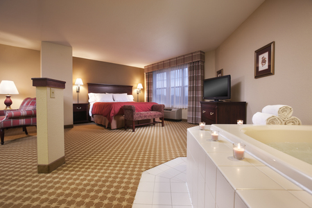 Celebration Suite with king bed, sofabed, mini microwave & refrigerator, 2 tv's, and jacuzzi tub