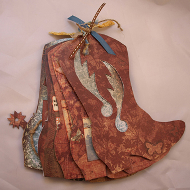 Cowboy (or CowGIRL!) Boot themed album; measures approximately 9x7, accommodates 19 photos of various sizes; perfect for girls' night out, bachelorette party, concert photos, etc.