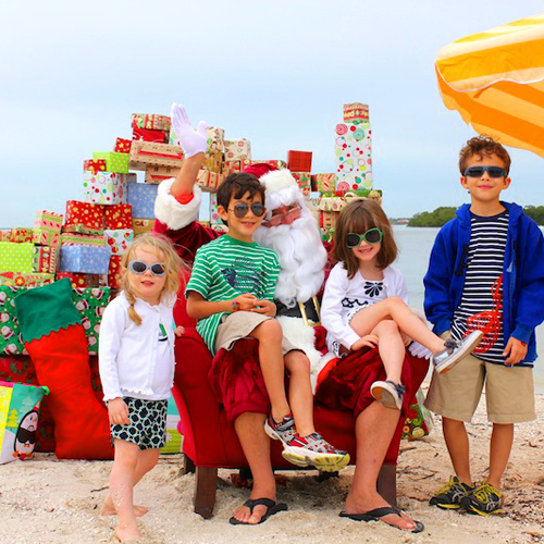 Cruise out among the dolphins to meet Santa on Christmas Tree Island!