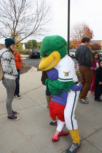 Maynard the Mallard gives hugs at Oak Bank's Great Pumpkin Give Away.