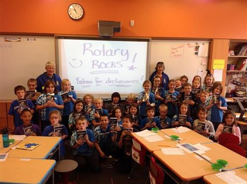Lander Rotary distributes dictionaries to local third graders