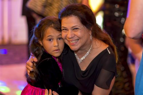 Samara, 2014 WalkAide Recipient at the Second Annual One Step At A Time Gala with Shirley, Mom.