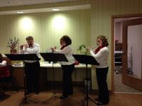 The LCCB Flute Trio plays at Wellbridge for the Senior Valentine's Day Party