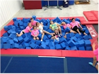 kids enjoying the inground trampoline and foam pit