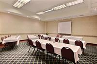 Executive room seats up to 30 people for a small business meeting