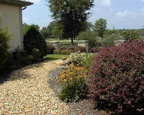 Here we divided a large, sprawling landscape into small, intimate outdoor spaces that were more useful and welcoming.