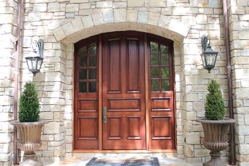 Flat arch 5 panel entry door with 2 8-light 2-panel sidelights