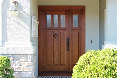 Craftsman ecnty door with 3 lights and 1 sidelight