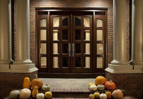Pair of 8-light entry doors with 2 4-light side lights