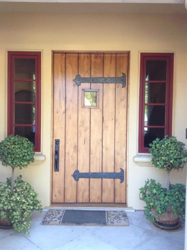 Plank style entry door with straps an speakeasy