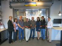 Ribbon cutting in new facility 29Jul2013