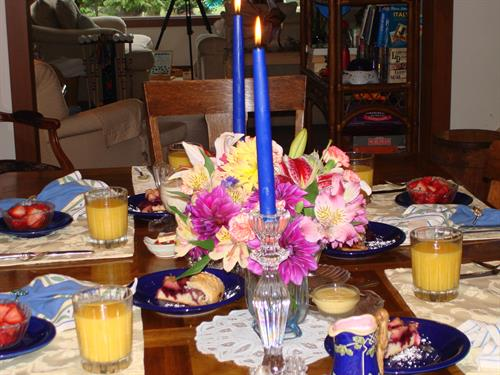 The Boreas breakfast table, full of flowers and fine breakfast dining!