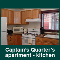 Gallery Image Captain's_Quarters_apartment_kitchen_view_1_chamber.jpg