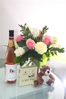 Love Bundle Package 12 premium roses artfully arranged  with a bottle of wine, truffles and cute cuddly bear.
