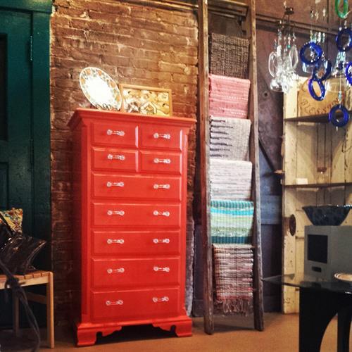 Renovated Thomasville dresser and loomed, vintage rag rugs.