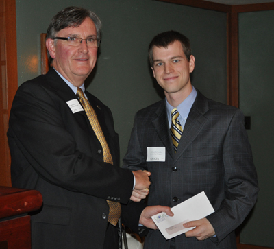Michael Schneider receives his CPA Certificate