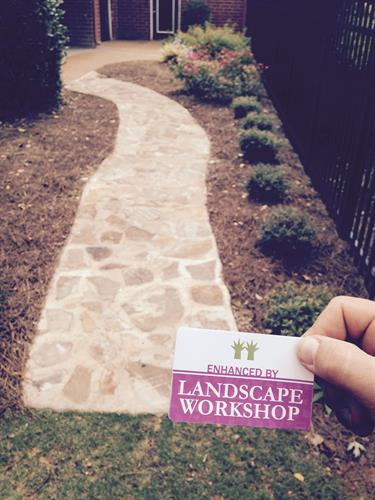 New natural stone walkway installed