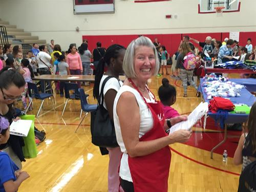 Happy volunteer at the 2015 Back to School Bonanza, KidzKare's annual health fair for local low income children and adolescents