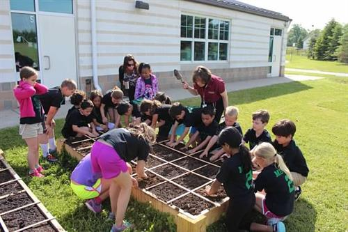 Planting seeds with Miss Michele