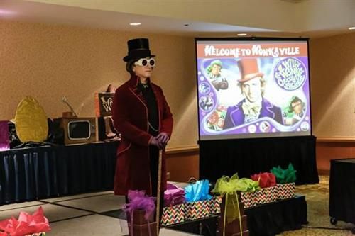 Willie Wonka presenting to the attendees