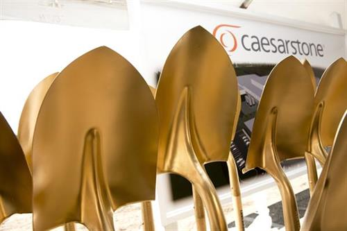 Caesarstone - special gold shovels to mark the occasion