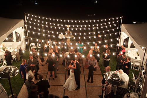 Rosewood outdoor dance floor, tents and bistro lighting