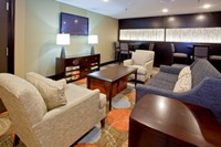 Our relaxing den features a complimentary DVD libray, books, and board games.