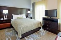 "All of our rooms feature a full kitchen, 32"" flat screen television, work desk, and sofa. Perfect for work or relaxing!"
