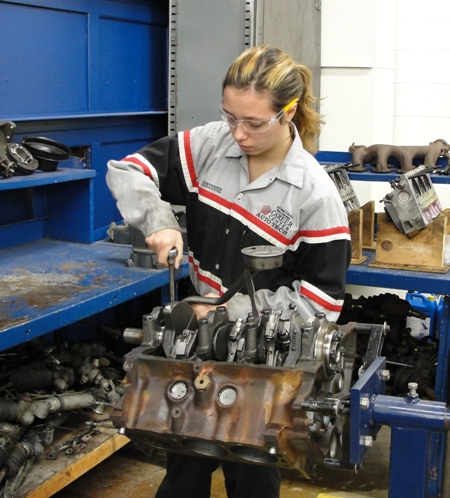 Students often enter non-traditional programs like this student in Auto Technology.