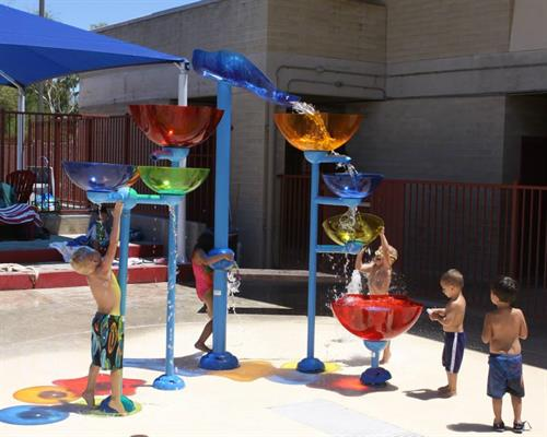 The splash pad at our Ott YMCA is always a blast for little ones!