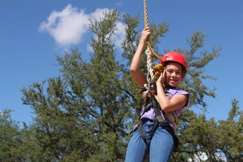 Our Triangle Y Ranch Camp has lots of fun activities including a climbing wall, zip line, and ropes course!