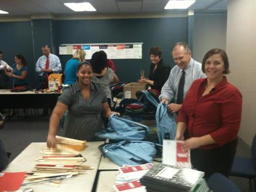 Stuffing backpacks for the back to school drive supporting The Boys and Girls Clubs of Tucson