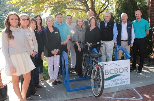 Ribbon cutting for Bike Rack and Fix-It Station placed in courtyard by our association!