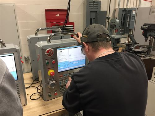 Night students working on the HAAS simulators for their CNC Certificate class at the Charlevoix High School