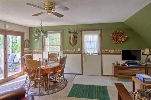 """The Pines Nature Suite has a dining area/living area with 40"""" HDTV, DVD Player and Direct TV"""