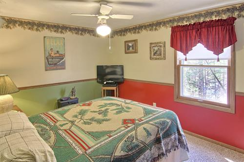 Frist Bedroom in the Pines Suite with queen size bed