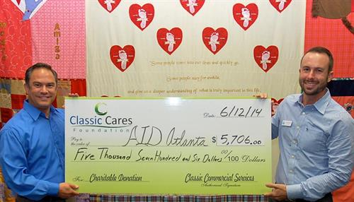 Justin Longenbach President of Classic Commercial Services, Inc was proud to present a check to AID Atlanta in the amount of $5,706.00 from the Classic Cares Foundation.