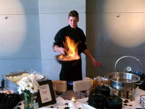 Jesse preparing flambeed bananas foster